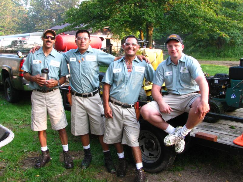 Clean landscapers in uniform